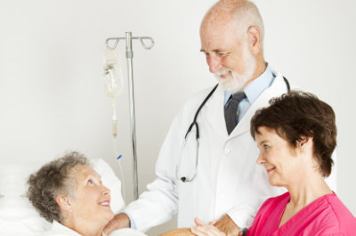 doctor with stethoscope and senior woman smiling